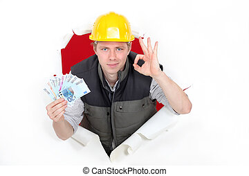 craftsman holding money and making an okay sign