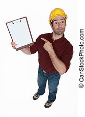 Construction worker pointing at his clipboard.