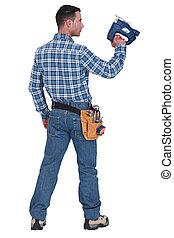 A handyman with a jigsaw.