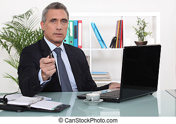 A businessman in his office