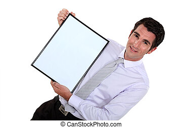 Businessman presenting blank advertising board