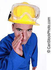 Worker wearing blue boiler suit