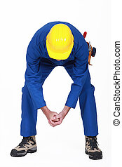 Worker bending over