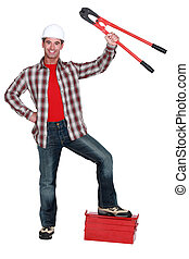 construction worker showing bolt cutters