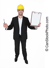 Happy man holding clip-board and pen