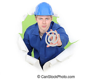 Manual worker with an @ sign