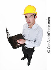 Worried engineer holding a laptop