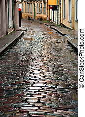 Wet street in Tallinn - Wet cobblestones after rain on...