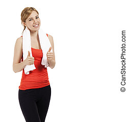 young beautiful fitness woman showing thumbs up on white background