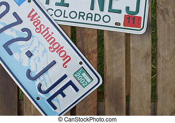 License Plates in Detail - A Washington and Colorado License...