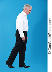 Businessman walking an imaginary tightrope