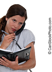 Receptionist scheduling an appointment