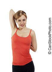 young fitness woman stretching her arms on white background