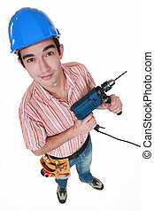 Young man with a power drill