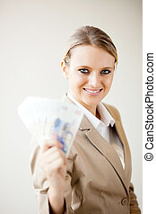 businesswoman holding cash notes - attractive young...