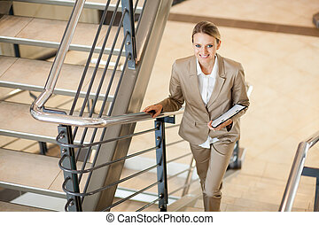 young businesswoman walking up stairs - cute young...