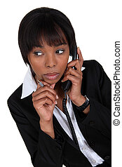 Woman paying attention during phone call