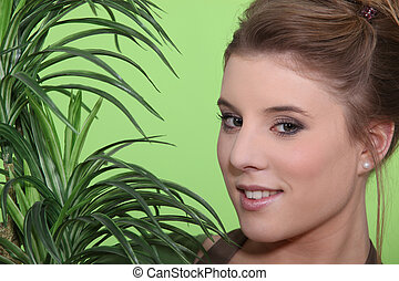 Woman with a houseplant