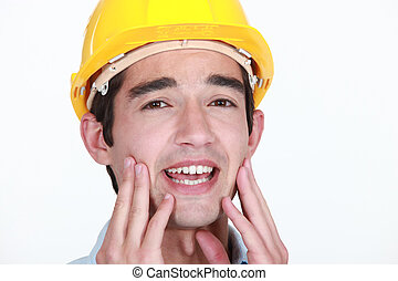 Construction worker with toothache