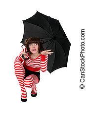 Eccentric woman with umbrella