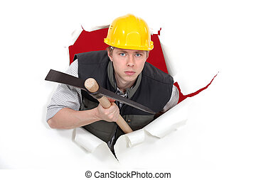 Man with pick-axe tearing through poster