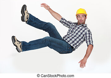 A construction worker in freefall