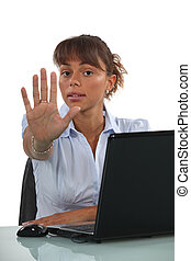 Businesswoman holding out hand in stop gesture