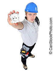electrician holding an electrical socket