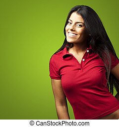 portrait of happy young girl smiling over green background
