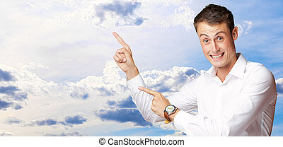Portrait Of Handsome Mature Man Pointing Up Over, Outdoor