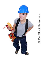 A female electrician with a voltmeter.