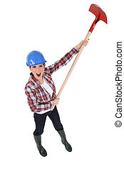 Woman yelling with a shovel in hands