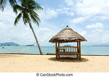 Tropical gazebo with chairs on amazing beach palm tree -...