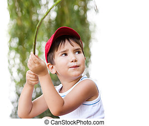 Portrait of a  3-4 years boy playing on the playground