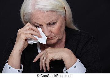 Elderly woman in pain