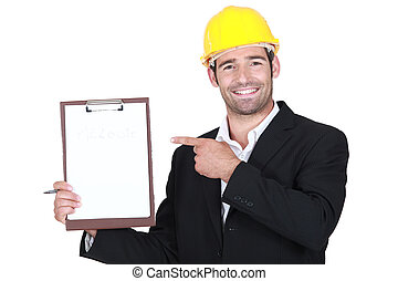 An architect pointing at his clipboard.