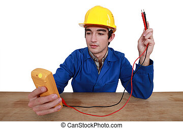 Tradesman using a multimeter