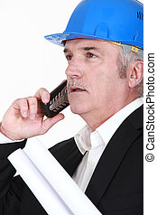 construction businessman talking on his cell phone
