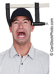 A man with a clamp on his head.