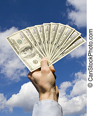 money in hand - Money in hand isolated on sky background