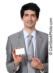 Businessman pointing at blank card