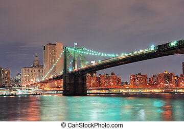 New York City Brooklyn Bridge with downtown skyline over...
