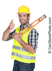 Man with spirit-level giving the thumbs-up