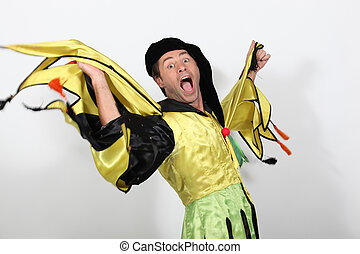 Man in a jester costume playing the fool