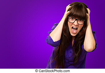 Frustrated Woman With Mouth Open Isolated On Purple...