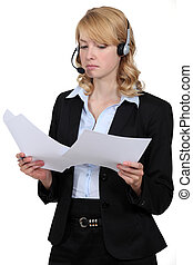 A blond businesswoman with a headset on