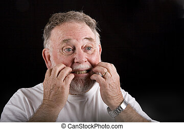 Old Man Scratching Face - An old man with beard and mustache...