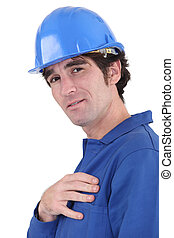 handsome blue collar wearing jumpsuit