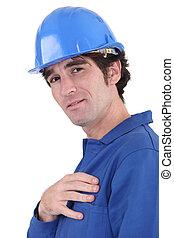 handsome blue collar wearing jumpsuit