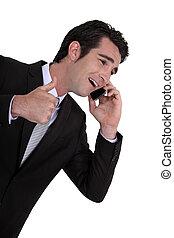 Businessman receiving good news